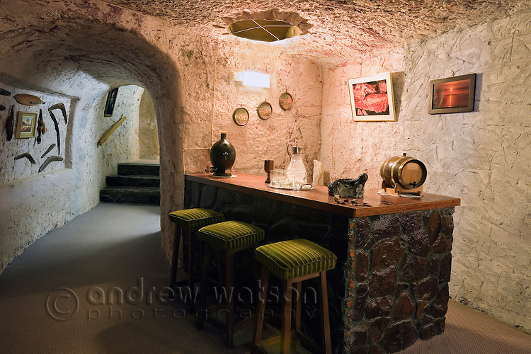 Bar area in Faye's underground home.  The famous home was built by three pioneering women in the 1960s using pick and shovel.  Coober Pedy, South Australia, AUSTRALIA.