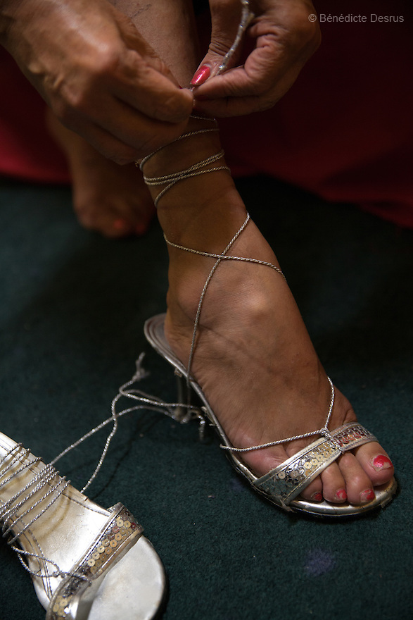Norma Angelica, a resident of Casa Xochiquetzal, puts on her high-heeled sandals at the shelter in Mexico City, Mexico on October 2, 2013. Casa Xochiquetzal is a shelter for elderly sex workers in Mexico City. It gives the women refuge, food, health services, a space to learn about their human rights and courses to help them rediscover their self-confidence and deal with traumatic aspects of their lives. Casa Xochiquetzal provides a space to age with dignity for a group of vulnerable women who are often invisible to society at large. It is the only such shelter existing in Latin America. Photo by Bénédicte Desrus
