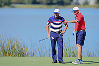 Bones helps Phil Mickelson (USA) read his putt on 10 during the practice round at the Ryder Cup, Hazeltine National Golf Club, Chaska, Minnesota, USA.  9/29/2016<br /> Picture: Golffile | Ken Murray<br /> <br /> <br /> All photo usage must carry mandatory copyright credit (&copy; Golffile | Ken Murray)