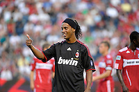 AC Milan midfielder Ronaldinho (80) gives a thumbs up to the crowd.  AC Milan defeated the Chicago Fire 1-0 at Toyota Park in Bridgeview, IL on May 30, 2010.