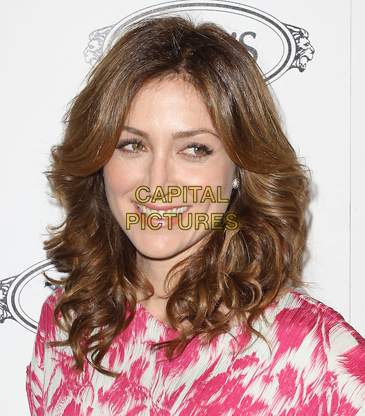 SASHA ALEXANDER.Tod's Beverly Hills boutique Grand Opening held At Tod's Boutique, Beverly Hills, California, USA. .April 15th, 2010 .headshot portrait pink print white smiling.CAP/ADM/KB.©Kevan Brooks/AdMedia/Capital Pictures.