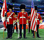 7 December 2008:  A Canadien Colour Guard Regiment presents the flags of Canada and the United States of America prior to the first regular season NFL game ever to be played in Canada between the Buffalo Bills and the Miami Dolphins at the Rogers Centre in Toronto, Ontario, Canada. The Dolphins defeated the Bills 16-3 in the historic event..