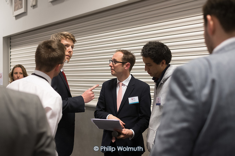 John Hooton, Returning Officer, talks to candidates before announcing result for ward.  London Borough of Barnet local election count.
