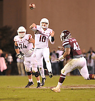 NWA Media/Michael Woods --11/01/2014-- w @NWAMICHAELW... University of Arkansas quarterback Brandon Allen scrambles to make a pass to tight end Hunter Henry in the 4th quarter of Saturday nights game against Mississippi State at Davis Wade Stadium in Starkville, Mississippi.