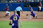 OKLAHOMA CITY, OK - JUNE 04: Deja Bush #9 of the Florida State Seminoles slides into second base against the Washington Huskies during the Division I Women's Softball Championship held at USA Softball Hall of Fame Stadium - OGE Energy Field on June 4, 2018 in Oklahoma City, Oklahoma. (Photo by Tim Nwachukwu/NCAA Photos via Getty Images)