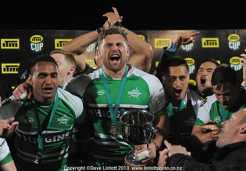 The Turbos celebrate winning the ITM Cup rugby chamiponship final match between Manawatu Turbos and Hawkes Bay Magpies at FMG Stadium, Palmerston North, New Zealand on Friday, 24 October 2014. Photo: Dave Lintott / lintottphoto.co.nz