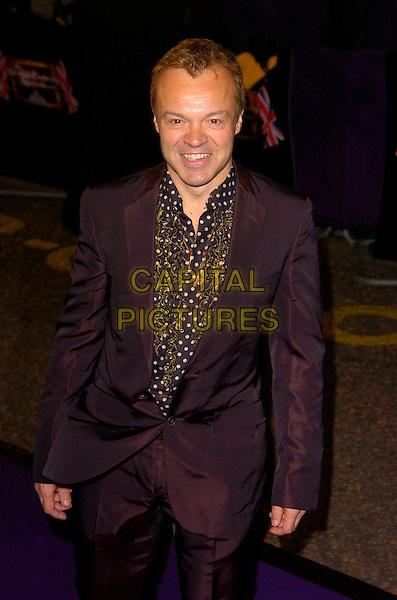 GRAHAM NORTON.British Comedy Awards 2007, London Studios, South Bank, London, England. .December 5th 2007.half length black jacket gold ruffled ruffles shirt 3/4 suit .CAP/CAN.©Can Nguyen/Capital Pictures