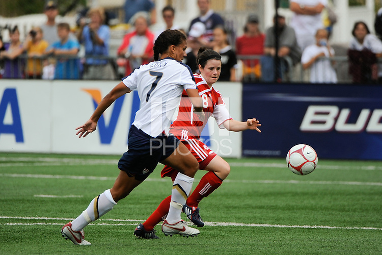 Shannon Boxx (7) of the United States (USA) and Diana Matheson (8) of Canada (CAN) go for the ball. The United States (USA) Women's National Team defeated Canada (CAN) 1-0 during an international friendly at Marina Auto Stadium in Rochester, NY, on July 19, 2009.