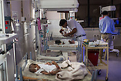 A nurse takes care of new born babies in the intensive care unit of the nursery  of the Duncan Hospital in Raxaul, Bihar, India.