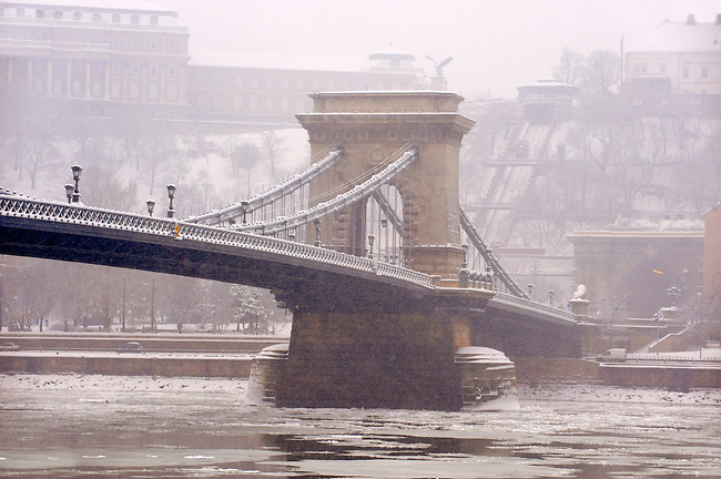 North Side of the Szechenyi Lanchid (Chain Bridge) in the winter snow. Budapest Hungary stock photos.