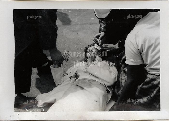 "Injured Woman on sidewalk being treated. On-The-Scene Accident Photograph, Elm & Orchard Streets New Haven CT circa December 1956. This photo is part of a set of 15 images captured of this accident by photographer Robert F. Anderson, Legal Photo Service. A scan of a 3.5""x5"" original lab print, negative or precise records not found. Not yet restored from deterioration, date is approximate."