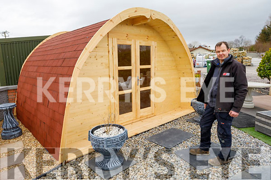 Mark Boyle of Boyle Patio's standing by their Glamping Pod