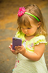 Toddler girl with i-phone.