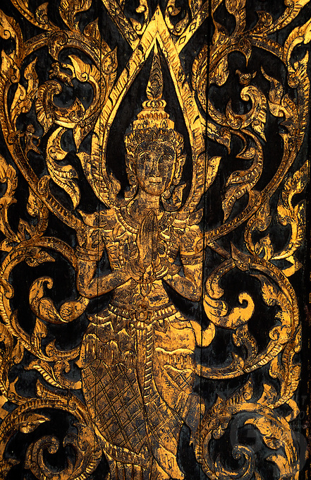 Old Door woodcarving with gold plated on Thai Apsara Figurine, Thailand