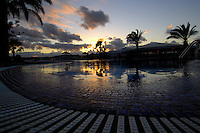 Swimming pool at dusk, Caleta Fuste harbour area, Fuerteventura, Canary islands,Spain.
