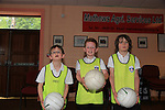 Robert Holmes<br /> Evan Dooley<br /> Raphael irwan<br /> at the GAA coaching in Collon NS<br /> Picture:  Fran Caffrey / www.newsfile.ie
