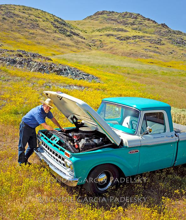 Jason Haase checks the engine in his 1968 Ford Pickup Truck, San Luis Obispo, California