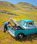 Jason Haase checks the engine in his 1968 Ford Pickup Truck, San Luis Obispo, California