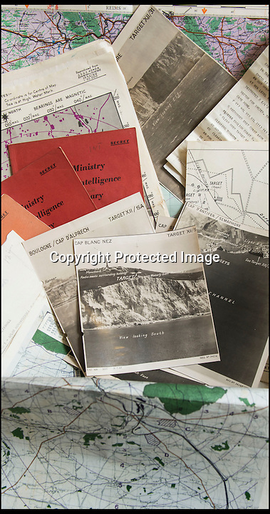 BNPS.co.uk(01202 558833)<br /> Pic: C&TAuctions/BNPS<br /> <br /> Found in a french flea market - a Top Secret 'how to' guide to D-Day.<br /> <br /> Fascinating top secret documents and photos of the extensive planning that went into the Normandy invasion have emerged after 72 years.<br /> <br /> Incredibly detailed plans of Nazi defences, high resolution photographs, weekly intel reports and even analysis of the German weapons they were likely to face are included in the sale.<br /> <br /> One photo taken at zero feet shows German troops scattering across a beach as a low-level RAF aircraft sweeps by to capture the plethora of anti-landing obstacles.<br /> <br /> Other images show the famous coastline with key cliff-top targets that had to be destroyed either before or on D-Day itself.<br /> <br /> The archive is being sold by C&T Auctions of Kent.