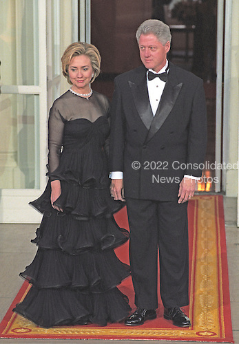 United States President Bill Clinton and first lady Hillary Rodham Clinton await the arrival of Premier Zhu Rongji of the People's Republic of China and his wife, Madame Lao An, for an Official Dinner in their honor on the North Portico of the White House in Washington, D.C. on April 8, 1999.<br /> Credit: Ron Sachs / CNP