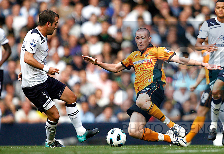 David Jones of Wolverhampton Wanderers puts in a hard tackle on Rafael van der Vaart of Tottenham Hotspur