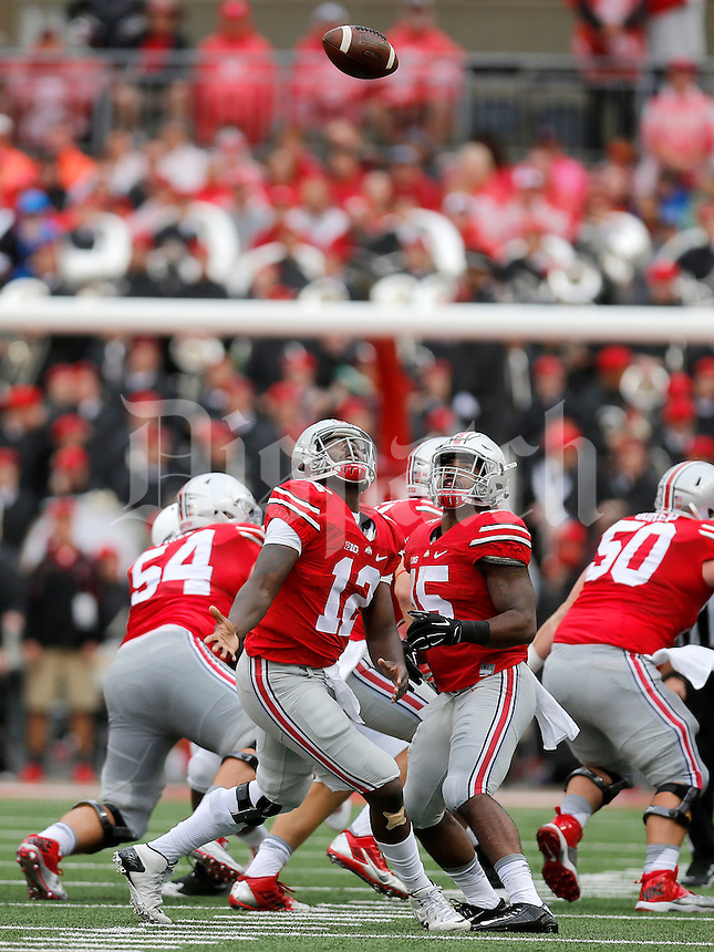 Ohio State Buckeyes quarterback Cardale Jones (12) and Ohio State Buckeyes running back Ezekiel Elliott (15) look at a high snap during the first half of the NCAA football game between the Ohio State Buckeyes and the Northern Illinois Huskies at Ohio Stadium on Saturday, September 19, 2015. (Columbus Dispatch photo by Jonathan Quilter)