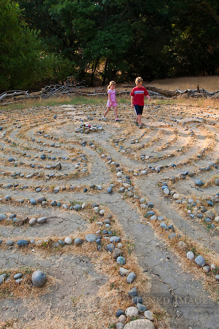 Young kids walking through a labyrinth maze, Briones Regional Park, Contra Costa County, California