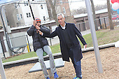 A ribbon cutting ceremony was held Sunday morning for the newly redesigned Sycamore Play Lot located at 51st and Greenwood.<br /> <br /> 9716 &ndash; Mayor Rahm Emanuel helps Zenin Miller on the new Zip Line on the playground.