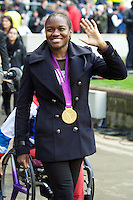 Nicola Adams, 2012 Olympics boxing gold medallist, is applauded by the crowd at halftime of the Cook Cup between England and Australia, part of the QBE International series, at Twickenham on Saturday 17th November 2012 (Photo by Rob Munro)