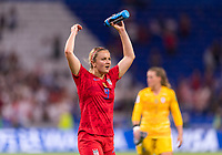 LYON,  - JULY 2: Lindsey Horan #9 salutes the crowd during a game between England and USWNT at Stade de Lyon on July 2, 2019 in Lyon, France.
