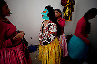 ".Aymara women known as ""Cholitas"" getting ready to wrestler on a Sunday afternoon..Just 25 years ago it was a small group of houses around La Paz  airport, at an altitude of 12,000 feet. Now El Alto city  has  nearly one million people, surpassing even the capital of Bolivia, and it is the city of Latin America that grew faster ...It is also a paradigmatic city of the tubles and traumas of the country. There got refugee thousands of miners that lost  their jobs in 90 ¥s after the privatization and closure of many mines. The peasants expelled by the lack of land or low prices for their production. Also many who did not want to live in regions where coca  growers and the Army  faced with violence...In short, anyone who did not have anything at all and was looking for a place to survive ended up in El Alto...Today is an amazing city. Not only for its size. Also by showing how its inhabitants,the poorest of the poor in one of the poorest countries in Latin America, managed to get into society, to get some economic development, to replace their firs  cardboard houses with  new ones made with bricks ,  to trace its streets,  to raise their clubs, churches and schools for their children."