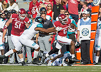 Hawgs Illustrated/BEN GOFF <br /> T.J. Hammonds, Arkansas running back, breaks the tackle of Shane Johnson (9) and Anthony Chesley (17), Coastal Carolina defenders, on his way to a touchdown in the second quarter Saturday, Nov. 4, 2017, at Reynolds Razorback Stadium in Fayetteville.