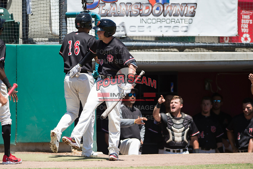 Visalia Rawhide third baseman Drew Ellis (10) congratulates Ramon Hernandez (16) after a two-run home run during a California League game against the Stockton Ports at Visalia Recreation Ballpark on May 9, 2018 in Visalia, California. Stockton defeated Visalia 4-2. (Zachary Lucy/Four Seam Images)