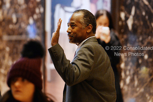 Former Republican presidential  candidate Ben Carson waves to bystanders as he walks through the lobby of the Trump Tower in New York, New York, on November 22, 2016.  United States President-elect Donald Trump has mentioned he is considering Mr. Carson for a cabinet post as the head of the Department of Housing and Urban Development (HUD). <br /> Credit: Anthony Behar / Pool via CNP