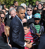 United States President Barack Obama greets family members and survivors from the attack during the commemoration of the 11th anniversary of the 9-11 attacks at the Pentagon, on September, 11, 2012 in Arlington, Virginia..Credit: Olivier Douliery / Pool via CNP