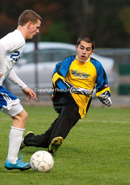 BURLINGTON, CT, 09 NOVEMBER 2010-110910JS06-Kaynor Tech goal keeper Paulo Dias comes out to challenge a shot by Lewis Mills' Evan Olson (29) during their Class M tournament game Tuesday at Nassahegan Park in Burlington. Olson scored on the play to help lift the Spartans to a 8-2 win.<br />  Jim Shannon Republican-American