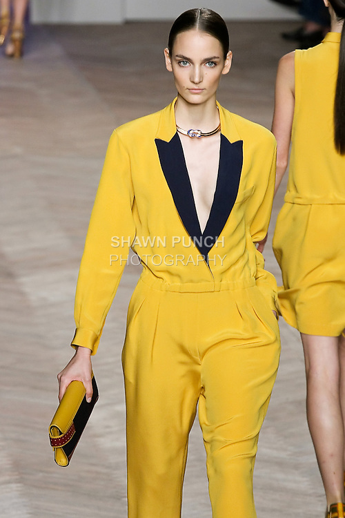 Zuzanna Bijoch walks the runway in a yellow/navy silk notch-lapel jumpsuit, by Tommy Hilfiger for the Tommy Hilfiger Spring 2012 Pop Prep Collection, during Mercedes-Benz Fashion Week Spring 2012.