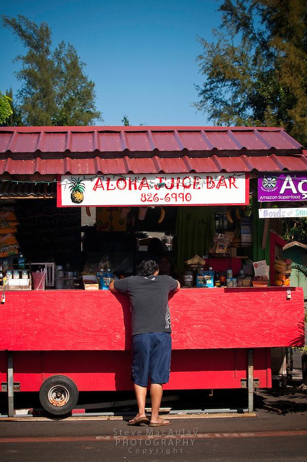 Buying smothies from the Aloha Juice Bar, Kauai Hawaii
