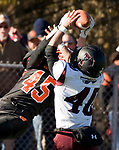 WATERTOWN, CT-112317JS08- Torrington's Starling Santos (40) breaks up a pass intended for Watertown's Joseph Deptula (45) during their Thanksgiving Day game Thursday at Watertown High School. <br /> Jim Shannon Republican-American