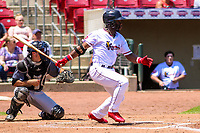 Cedar Rapids Kernels outfielder Akil Baddoo (24) swings at a pitch during a Midwest League game against the Clinton LumberKings on May 28, 2018 at Perfect Game Field at Veterans Memorial Stadium in Cedar Rapids, Iowa. Clinton defeated Cedar Rapids 4-3. (Brad Krause/Four Seam Images)