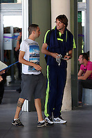 Wednesday 18 September 2013<br /> Pictured: Michu (R) speaks to a fan outside Valencia Airport.<br /> Re: Swansea City FC players and staff travelling to Spain for their UEFA Europa League game against Valencia.