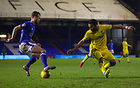 Oldham Athletic's Cameron Dummigan (L) vies for possession with AFC Wimbledon's Andy Barcham (R) during the Sky Bet League 1 match between Oldham Athletic and AFC Wimbledon at Boundary Park, Oldham, England on 21 November 2017. Photo by Juel Miah/PRiME Media Images
