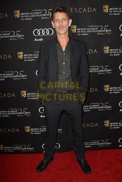 Jamie Harris.18th Annual BAFTA Los Angeles Awards Season Tea Party held at the Four Seasons Hotel, Beverly Hills, California, USA..January 14th, 2012.full length black suit grey gray shirt hands in pockets .CAP/ADM/KB.©Kevan Brooks/AdMedia/Capital Pictures.