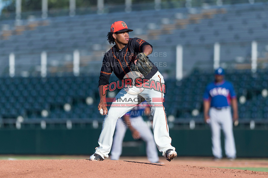 AZL Giants Orange starting pitcher Johan Herrera (40) delivers a pitch during an Arizona League game against the AZL Rangers at Scottsdale Stadium on August 4, 2018 in Scottsdale, Arizona. The AZL Giants Black defeated the AZL Rangers by a score of 3-2 in the first game of a doubleheader. (Zachary Lucy/Four Seam Images)