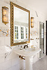 Aspen, a hand-cut stone mosaic, shown in polished Calacatta Tia, Saint Laurant, Persian Gold and Sylvia Gold with 24K Gold Glass.<br />