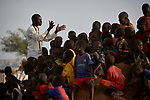 Ganun Butros Wadko sings with a group of children in the Doro Refugee Camp in Maban County, South Sudan. Doro is one of four camps in Maban which together shelter more than 130,000 refugees from the Blue Nile region of Sudan. Jesuit Refugee Service, with support from Misean Cara, provides educational and psychosocial services to both refugees and the host community. Wadko, a refugee himself, is supervisor of the JRS psychosocial team's home visits in the Doro Camp.