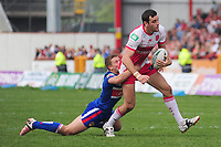 Hull Kingston Rovers' Craig Hall is tackled by Wakefield Trinity wildcats' Kyle Wood <br /> <br />  (Photo by Chris Vaughan/CameraSport) <br /> <br /> Rugby League - Stobart Super League - Hull Kingston Rovers v Wakefield Wildcats - Sunday 19th May 2013 - MS3 Craven Park - Hull<br /> <br /> © CameraSport - 43 Linden Ave. Countesthorpe. Leicester. England. LE8 5PG - Tel: +44 (0) 116 277 4147 - admin@camerasport.com - www.camerasport.com