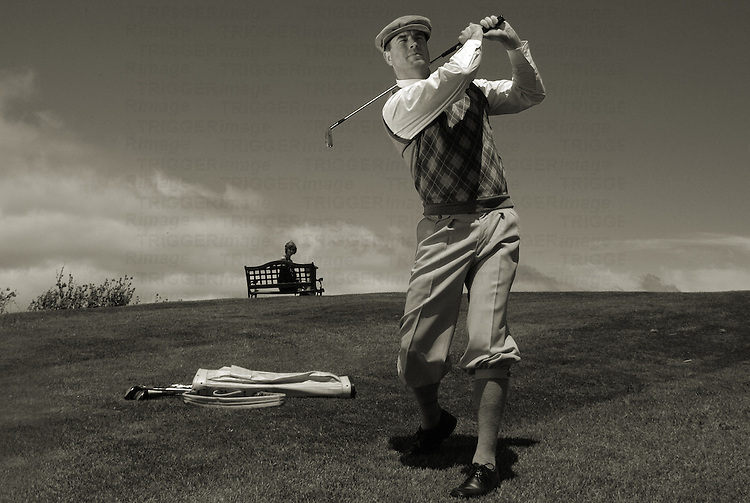 A middle aged man playing golf