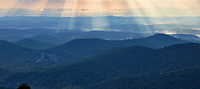 View of the Blue Ridge mountains and sunrays from a Blue Ridge Parkway overlook at Rocky Knob Recreation Area, Virginia