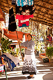 MEXICO, San Pancho, San Francisco, a woman taking down merchandise at her store near San Pancho Beach